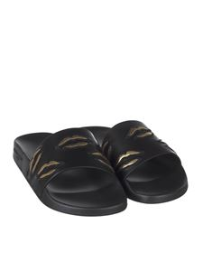 Givenchy - Black rubber slides with Bouches embroidery