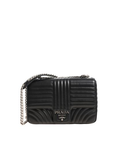 f1f4a6e7570f Prada Carrie Over quilted black leather shoulder bag - 1BD135 2D91 F0633
