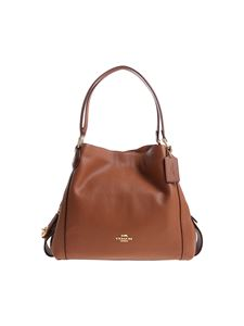 Coach - Tan colored leather bag with golden logo