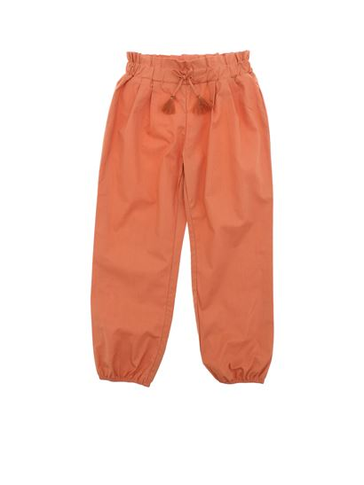 Chloé - Orange trousers with elastic waistband