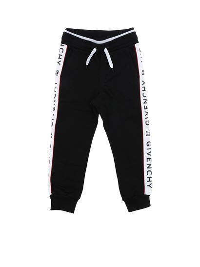 Givenchy - Black trousers with white stripes