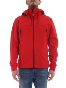 CP Company - Red jacket with hood and glasses