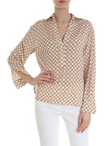 D.Exterior - Cream white blouse with ring motif