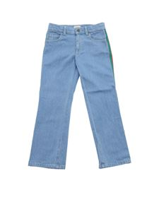 Gucci - Light blue jeans with Gucci bands