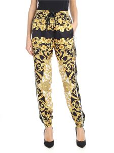 Versace - Hibiscus printed trousers in black and yellow