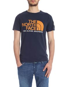 The North Face - T-shirt in blue with orange print