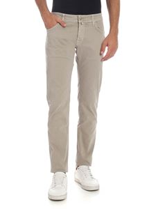 Jacob Cohën - Faded effect trousers in beige with calfhair logo
