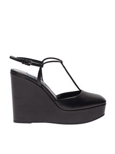 Prada - T-strap wedges in black leather