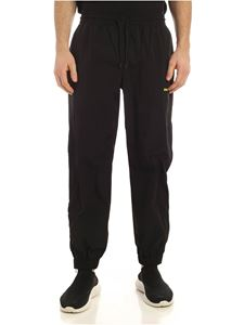 MSGM - Neon yellow logo print trackpants in black