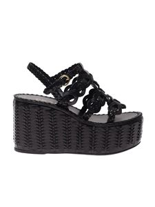 Prada - Sandals in black with leather wedge