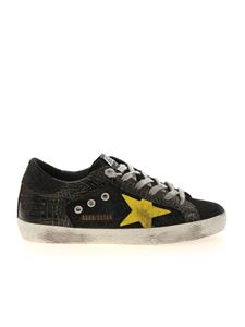 Golden Goose - Superstar sneakers in black and gold