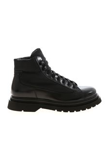 Prada - Leather ankle boots in black featuring logo
