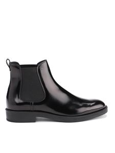 Tod's - Patent leather ankle boots in black