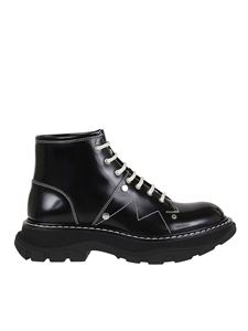Alexander McQueen - Studded polished leather booties in black