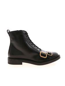 Tod's - Low black ankle boots featuring golden buckles