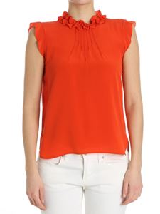 True Royal - Lobster-color top with ruffles on the neckline